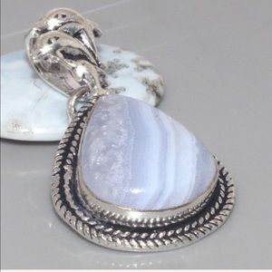 Jewelry - Blue lace pendant with silver overlay